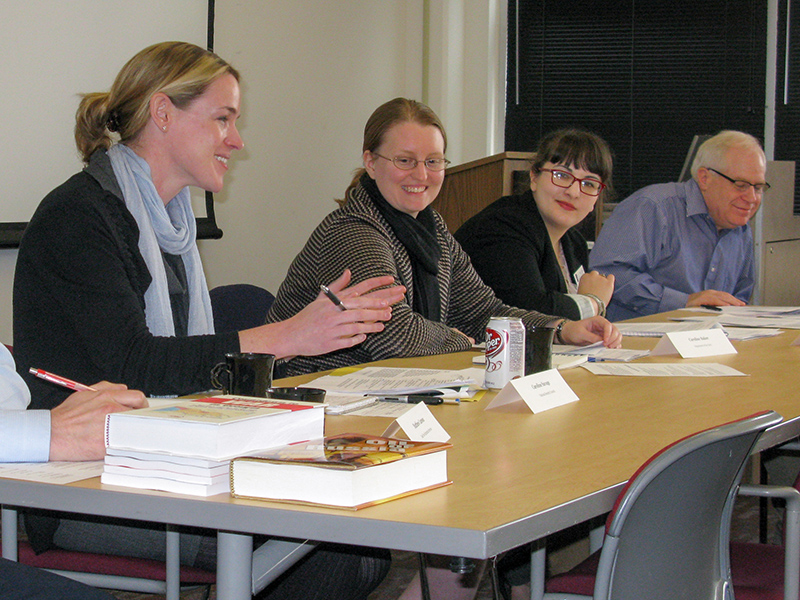 Caroline Baker and three others sitting at a desk as an informational panel for MA students