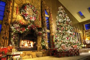 christmas tree and decorations next to fireplace